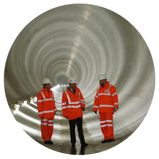 Photo of three workers standing in the Lee Tunnel