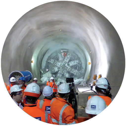 Photo of workers standing in a Crossrail tunnel in London